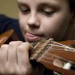 gitaarles.jongen